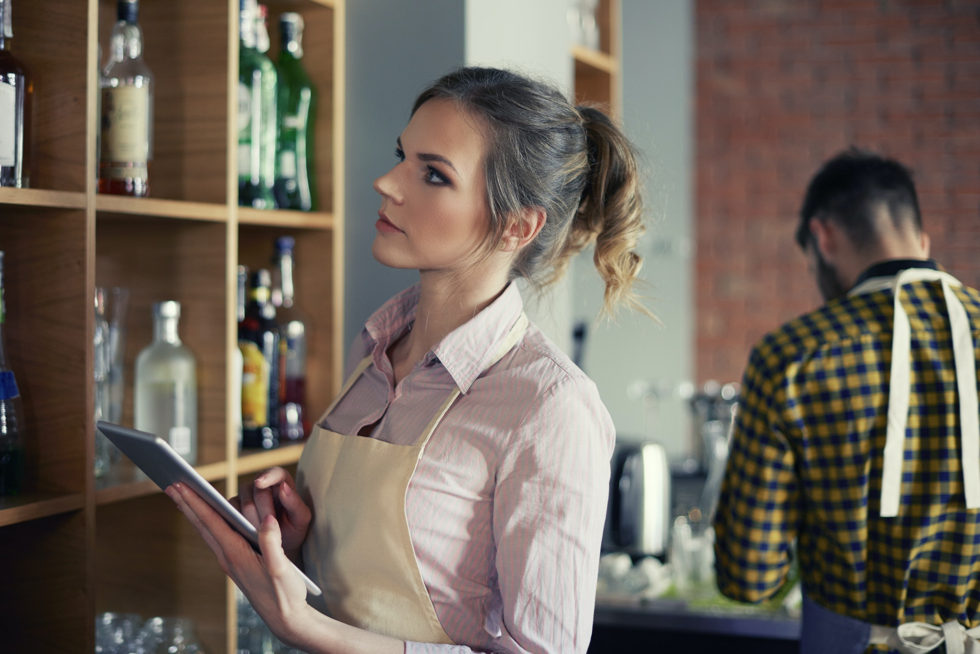 Waitress ordering products by digital tablet